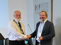 Stewart Henchie presents Noel McGough with his Kew Guild Medal